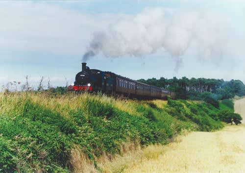 The North Norfolk Railway steaming through the countryside